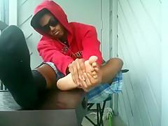 Boy shows feet...