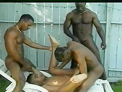 Four men roll around naked blowing cock...