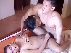 3 on a bed...