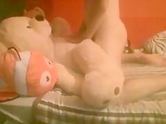 Boy plays with teddy stuffed animals...