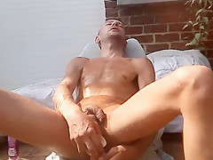 Outdoors backyard dildo deep inside his male pussy...