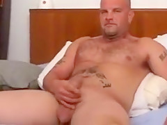 Bear plays with his cock...