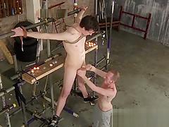 Deviant master gives slave a handjob...