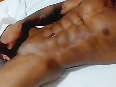 Healed and tattooed black boy masturbating big black...
