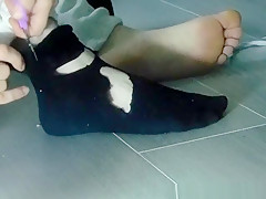 Cutting off black socks...
