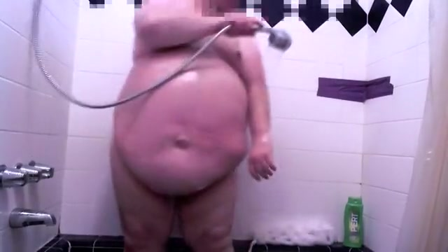 Fat guy taking a shower Guess bikini yello polka dots