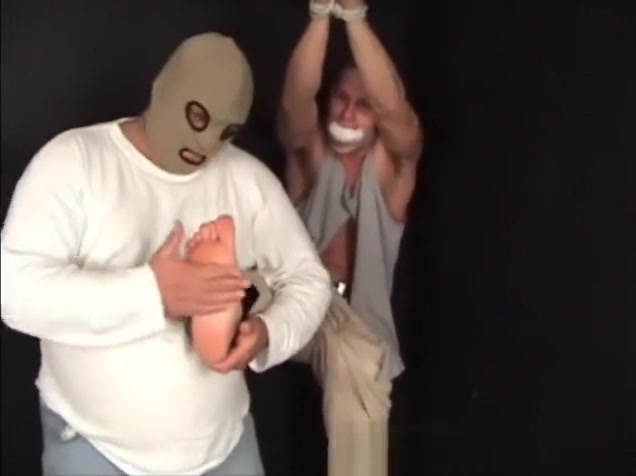 Handsome ex-military stud strung up by hs wrists gagged and stripped. graham heather killing scene sex softly