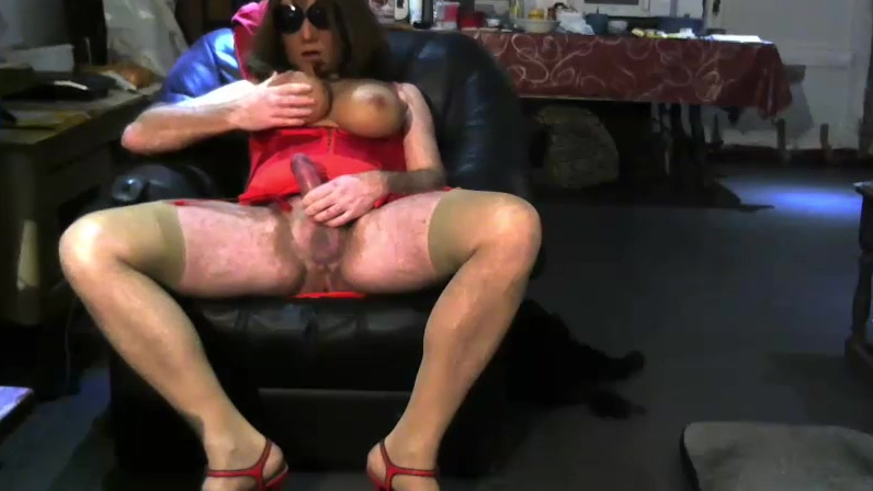 Red corset on the sofa Lesbian foot slave mature
