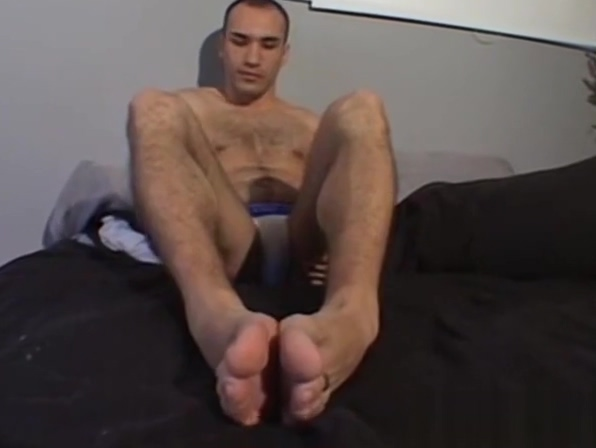 Cute stud gently playing with his feet and licking his toes red calvin klein underwear