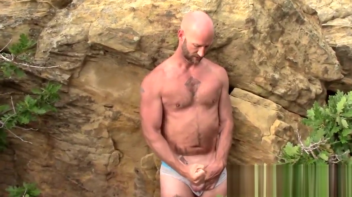 Bald amateur with a beard wanks off outdoors and gets sucked Backstage of porn film