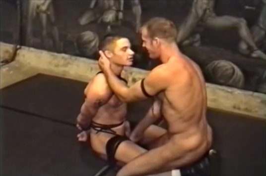 Roped up guy nude sword fighting