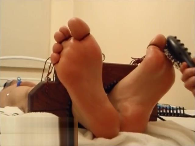tickle toy feet on the table tickling Shara in a bikini