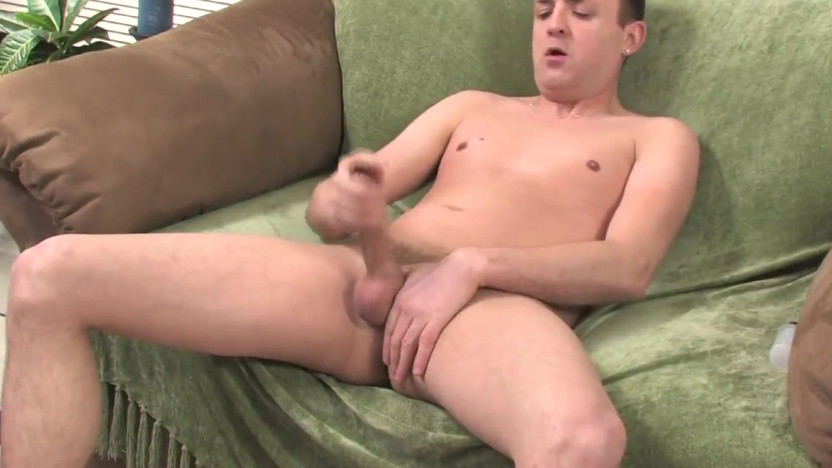 Brunette guy next door has a wank on a green sofa Of chubby cheecks