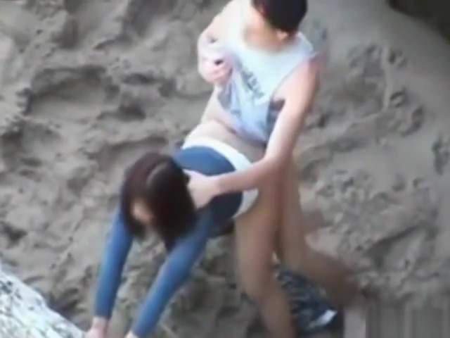 Naughty couple fucking on public beach Sexi porn star