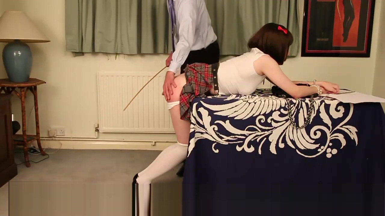 Brunette crossdresser schoolgirl gets hard ass spanking over the desk for cheating with Luci May free synchronized squirting porn videos