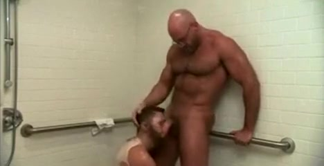 Bear fucked in the shower. Having sex with a strap on